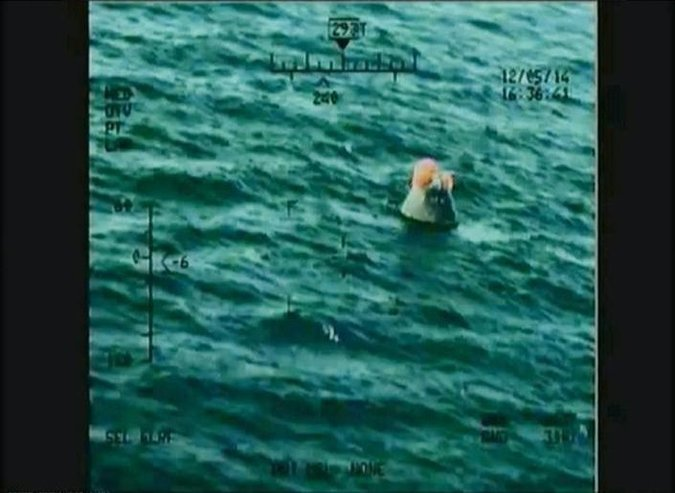 The Orion spacecraft floating in the Pacific Ocean after splashdown on Friday. The image is taken from video released by NASA. Credit NASA, via Reuters