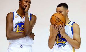 Golden State Warriors' Kevin Durant, left, and Stephen Curry joke as they pose for photos during NBA basketball media day Monday, Sept. 26, 2016, in Oakland, Calif. (AP Photo/Marcio Jose Sanchez)